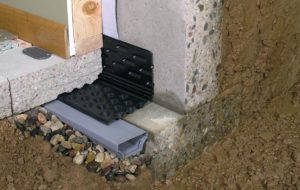 Basement waterproofing products inside a home in Providence